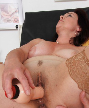 Older woman Simi having aged vagina examined by gyno doctor with speculum