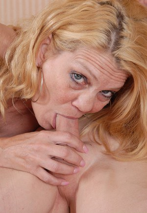 Close ups of over 50 MILF Lori giving her man's cock a blowjob