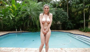 Petite babe Molly Jane letting large tits loose outdoors beside pool