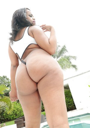 Black booty model Dani Dreamz strutting her fat ass beside swimming pool