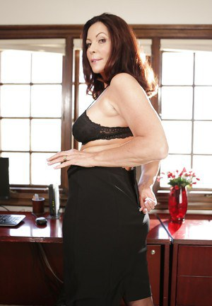 Mature boss woman Magdalene St Michaels stripping naked in office