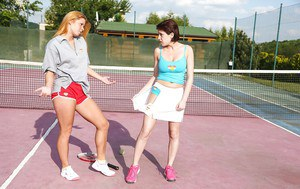Teen chick Anabelle and dyke girlfriend having lesbian sex on tennis court