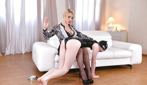 Clothed blonde domme forces hooded latex sub slut to lick MILF from dish
