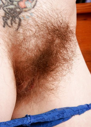 Close ups of mature hairy model Tink showing off pierced nipple