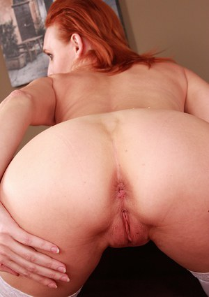 Aged redhead mom Bachova parting shaved vagina for finger fucking action