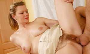 Blonde cougar Kelli jerking a cock for eventual cumshot on hairy pussy