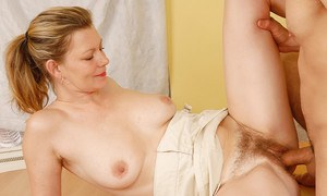 Older blonde lady Kelli fingering hairy vagina while giving a blowjob