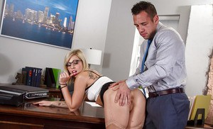 Glasses adorned blonde Zoey Monroe taking entire ball sac in mouth
