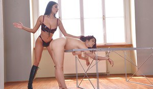 Brunette domme Anissa Kate having her way with bound slave Zenda Sexy