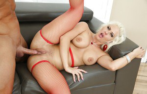 Blonde pornstar Holly Heart pegging muscular stud in red fishnets