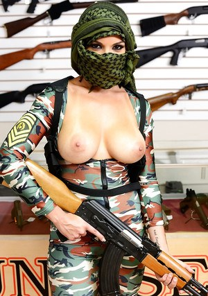 Camouflaged chick with rifle in hand lets her big natural breasts loose