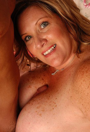Freckled mature fatty Deedra eating sperm after giving a titjob