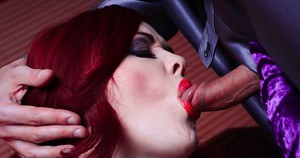 Redhead fetish model Jaye Rose giving a blowjob during cosplay games