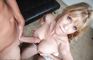 Fully clothed blonde mommy licking and blowing thick penis