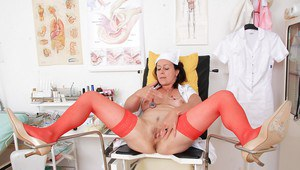 Mature head nurse Simi posing non nude in full nurse uniform