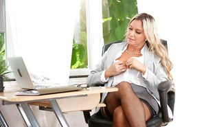 Blonde office worker Angela flashing upskirt leg and hose at work