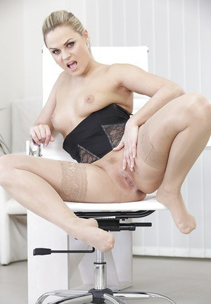 Blonde Euro secretary Bara Brass undressing at work for nude photo spread