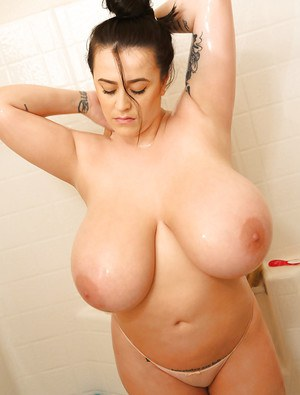 Chesty brunette model Leanne Crow and her huge juggs take a shower