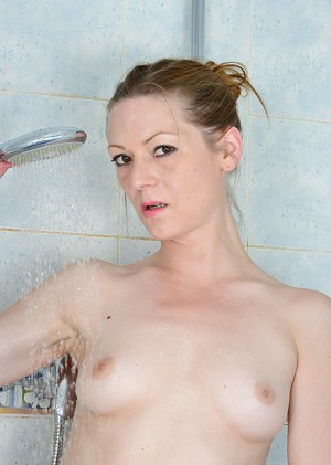 Fit mature French woman Mischelle revealing small breasts in shower