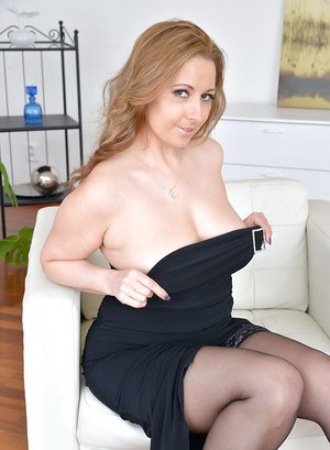 Fully clothed MILF Daria Glower spreads nylon clad legs to flash panties