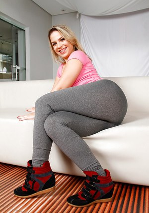 Blond Brazilian chick Flavia Oliveira removing spandex pants for nude poses