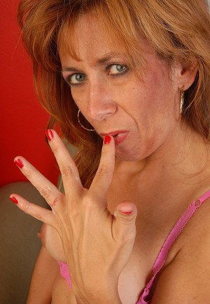 Experienced redhead Mikela eating cum from fingers after giving blowjob