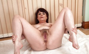 Close ups of thick mature lady Christina X showing off pubic hairs