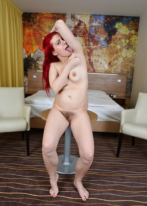 Older redheaded Euro broad Corazon Del Angel flashing upskirt underwear