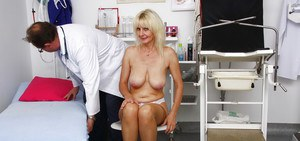 Mature woman Mia letting saggy granny boobs hang while doctor examines her