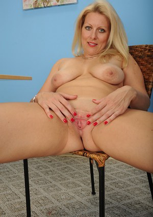 Aged blonde Zoey Tyler letting pink undies slip over ass and fall on floor