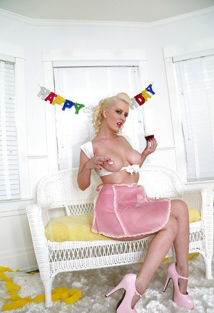 Busty blonde pinup model Cherry Torn letting nice big boobs free from bra