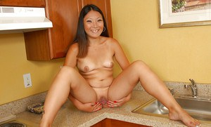 Asian first timer Miki removing bikini bottoms in kitchen