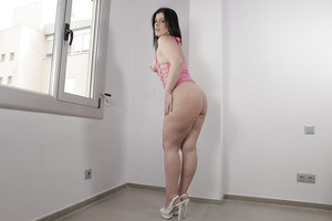 Fat assed brunette chick in high heels spreading shaved vagina