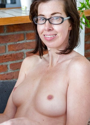 Aged nerd Bonnie C flashing hairy upskirt pussy for close ups