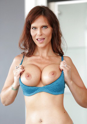 Mature MILF Syren Demer posing fully clothed in long skirt