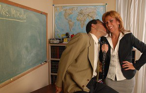 Aged mature teacher Mikela taking dick in shaved pussy on desk at school