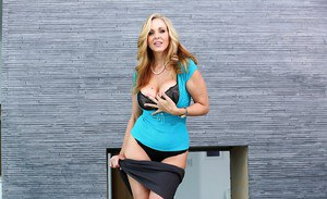 Busty blonde MILF babe model Julia Ann undressing outdoors for nudies