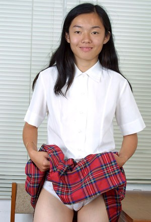 Asian first timer Tiffany removing schoolgirl uniform to pose in nude