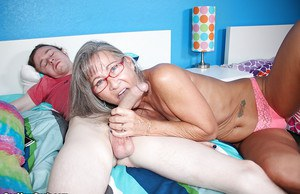 Glasses adorned granny sucks and tugs on a younger man's dick
