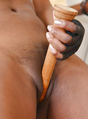 Fit ebony MILF Jasmine Webb inserting wooden dildo in shaved pussy
