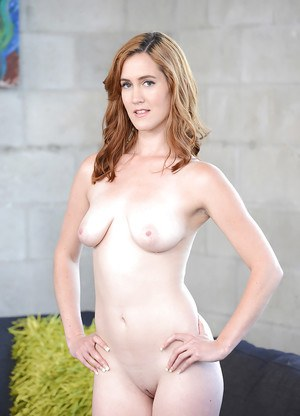 Young MILF Veronica Avluv undressing for nude photo spread