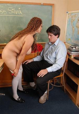 Buxom teacher Miss Silvia helps her student by sucking his cock in class