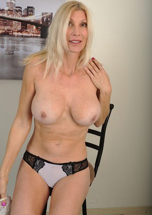 Mature blonde MILF Cameo posing fully clothed in skirt and heels