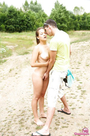 Busty blonde teenager Adelle receiving cunnilingus in the forest