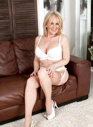 Older blonde stocking and nylon model Alexia Blue posing non nude