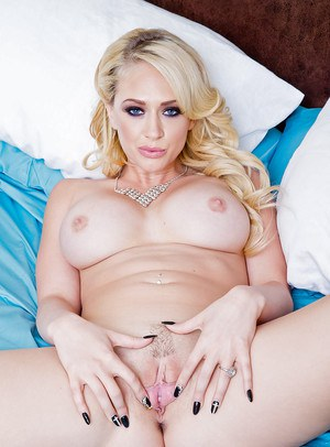 Hot blonde babe Kagney Linn Karter showing off trimmed pussy and ass