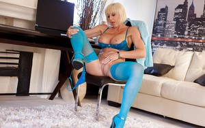 Mature nylon model Jan Burton masturbating in blue hosiery and heels