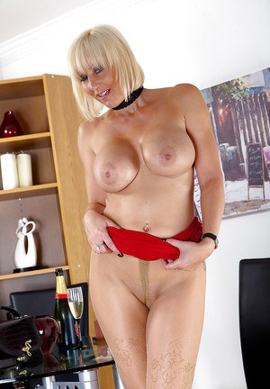 Older blonde lady Jan Burton pulls down pantyhose for masturbation