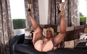 Mature blonde woman Jan Burton posing non nude in granny pants and hose
