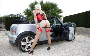 Hot Euro lady Jan Burton flashing stocking tops and garters outdoors